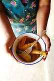 BELIZE, Punta Gorda, Toledo District, Desiree Mes holds a chicken dish she prepared in her home, San Jose Maya Village