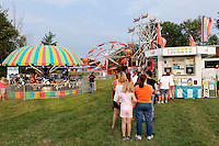 Patrons wait for tickets at the Louisa County fair.  Photo/Andrew Shurtleff