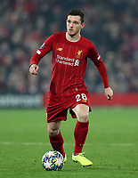 5th November 2019; Anfield, Liverpool, Merseyside, England; UEFA Champions League Football, Liverpool versus Genk; Andy Robertson of Liverpool controls the ball and looks up for a team mate - Editorial Use