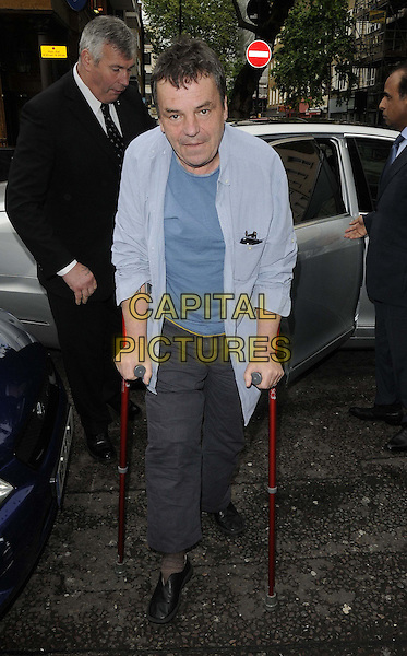 "Neil Jordan.attended the ""Byzantium"" gala film screening, Charlotte Street Hotel, Charlotte St., London, England..May 28th, 2013.full length blue shirt top trousers crutches .CAP/CAN.©Can Nguyen/Capital Pictures."