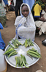 A girl displaced by violence in the Darfur region of Sudan sells okra in the market of the Goz Amer refugee camp in eastern Chad. More than a quarter million residents of Darfur live in camps in Chad, along with almost 200,000 Chadians who have been internally displaced by related violence.