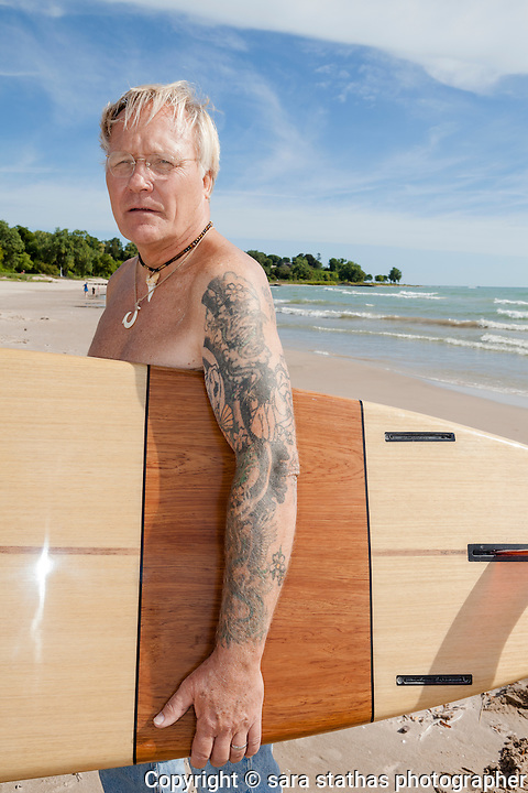 "Larry ""Longboard"" Williams, co-founder of the Dairyland Surf Classic on the beach on Lake Michigan in Sheboygan, Wisconsin"