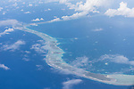 Arutua Atoll, Tuamotu Archipelago, French Polynesia; aerial views of the Arutua Atoll while flying south from Rangiroa to Fakarava