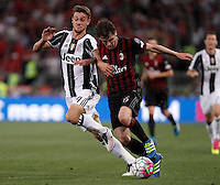 Calcio, finale Tim Cup: Milan vs Juventus. Roma, stadio Olimpico, 21 maggio 2016.<br /> AC Milan&rsquo;s Andrea Poli, right, is challenged by  Juventus&rsquo; Daniele Rugani during the Italian Cup final football match between AC Milan and Juventus at Rome's Olympic stadium, 21 May 2016.<br /> UPDATE IMAGES PRESS/Isabella Bonotto
