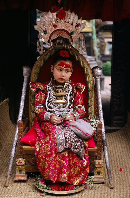 The LIVING GODDESS in her full regalia sits on her thrown during the Rato Machendranath Festival - PATTAN, NEPAL