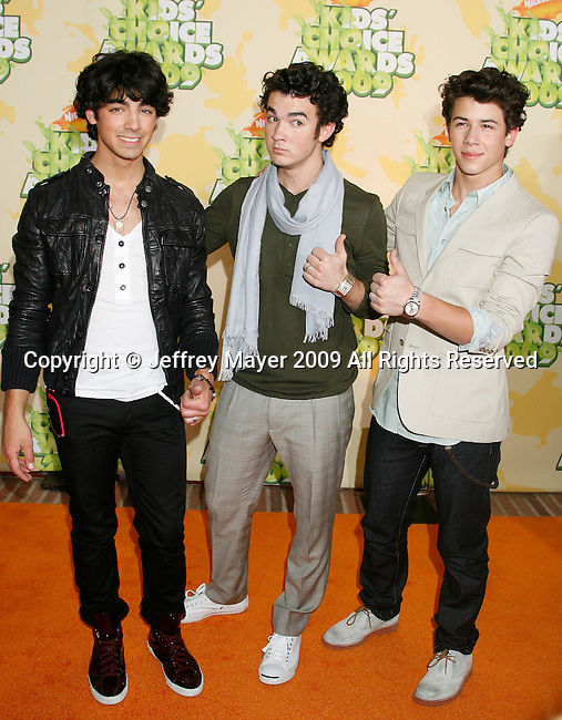 WESTWOOD, CA. - March 28: Musicians Joe Jonas, Kevin Jonas and Nick Jonas of Jonas Brothers arrive at Nickelodeon's 2009 Kids' Choice Awards at UCLA's Pauley Pavilion on March 28, 2009 in Westwood, California.