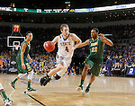 SIOUX FALLS, SD - MARCH 8:  Jake Bittle #4 from South Dakota State drives to the basket against Kory Brown #22 from North Dakota State during the 2016 Summit League Championship Game Tuesday at the Denny Sanford Premier Center in Sioux Falls, S.D. (Photo by Dave Eggen/Inertia)