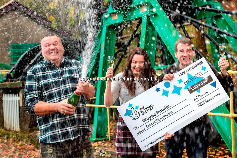 Pictured L-R: £1million winner Wayne Rowles, with daughter Laura, and his brother Terence Rowles<br /> Re: A full-time carer from Port Talbot is celebrating after winning a life-changing £1,000,000 on the EuroMillions UK Millionaire Maker.<br /> Wayne Rowles, 45, spends much of his time looking after his 82 year old father and a couple of his elderly friends. Last Friday he popped out to buy each of them a paper when he decided to try his luck on the EuroMillions.<br /> The next morning he had some rare time alone and decided to check Friday night's (21 October) EuroMillions results on his television's red button.