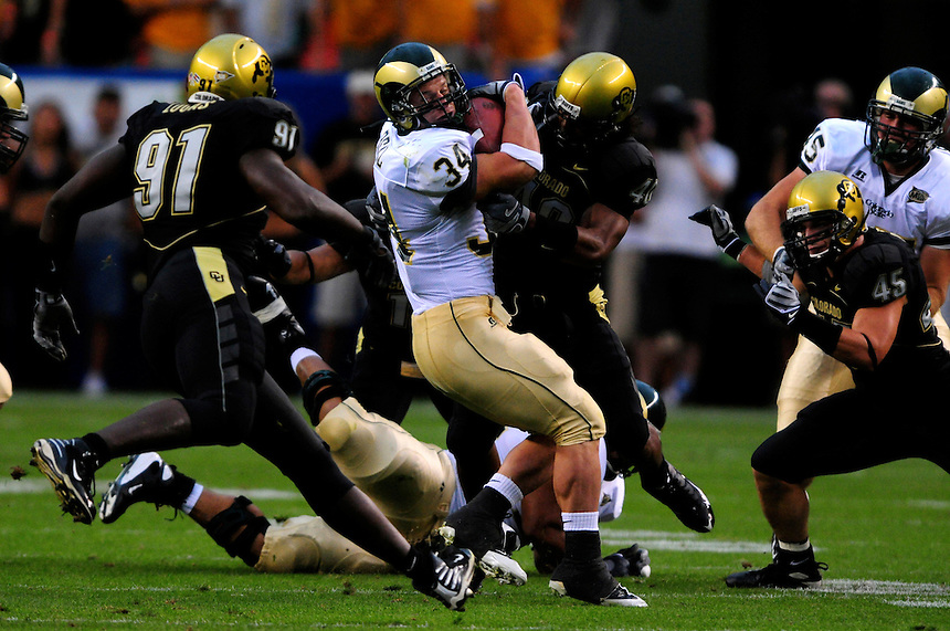 31 Aug 2008: Colorado State running back Kyle Bell (34) is stopped by Colorado linebacker Brad Jones (40) The Colorado Buffaloes defeated the Colorado State Rams 38-17 at Invesco Field at Mile High in Denver, Colorado. FOR EDITORIAL USE ONLY