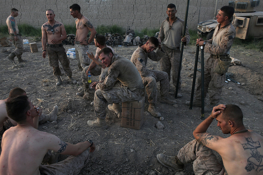 Marines from Alpha Co. 1st Battalion 5th Marines begin to set up their new combat outpost after entering the Nawa District of Afghanistan's Helmand Province during Operation River Liberty which began on July 2, 2009.