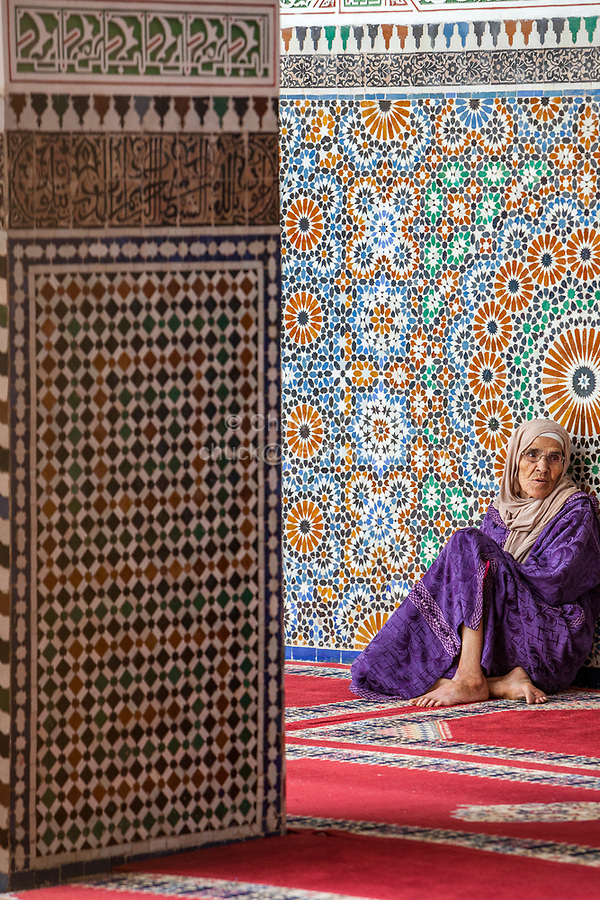 Fes, Morocco.  Old Woman Resting in the Zaouia of Moulay Idris II, in the Medina, Fes El-Bali.