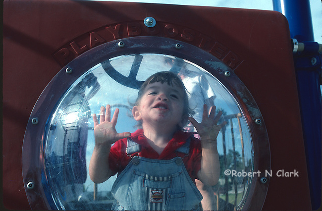 Boy behind bubble at park