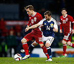 Christian Eriksen of Denmark tussles with Shaun Maloney of Scotland during the Vauxhall International Challenge Match match at Hampden Park Stadium. Photo credit should read: Simon Bellis/Sportimage