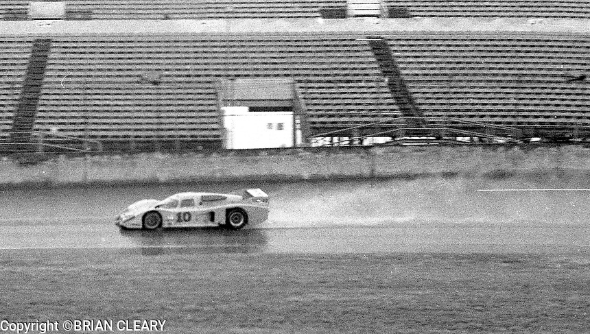 #10 Lola of Ralph Kent Cooke, Jim Adams, adn John Bright leaves a rooster tail as it races in the rain during the 1983 24 Hours of Daytona , Daytona Internationa Speedway, Daytona Beach, FL, February 1-2, 1983.  (Photo by Brian Cleary / www.bcpix.com)