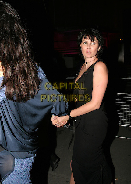 SADIE FROST.Private view to open the V&A's major Westwood exhibition.30 March 2004.holding hands.www.capitalpictures.com.sales@capitalpictures.com.© Capital Pictures.