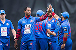 Marlon Samuels of Kowloon Cantons (L) celebrates with his team after taking the wicket during the Hong Kong T20 Blitz match between Kowloon Cantons and HKI United at Tin Kwong Road Recreation Ground on March 11, 2017 in Hong Kong, Hong Kong. Photo by Marcio Rodrigo Machado / Power sport Images