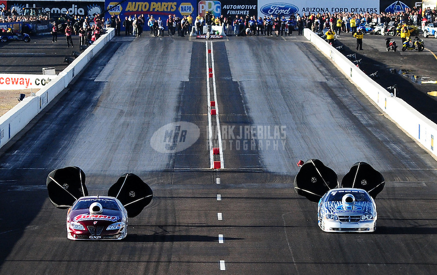 Feb. 20, 2010; Chandler, AZ, USA; NHRA pro stock driver Greg Anderson (left) races alongside Allen Johnson during qualifying for the Arizona Nationals at Firebird International Raceway. Mandatory Credit: Mark J. Rebilas-