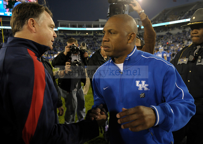 Kentucky Wildcats head coach Joker Phillips and Ole Miss coach Houston Nutt shake hands after the University of Kentucky football game against Ole Miss at Commonwealth Stadium in Lexington, Ky., on 11/5/11. Uk won the game 30-13. Photo by Mike Weaver | Staff
