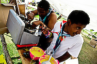 Two scouts from Trinidad and Tobago preparing their traditional food. Photo: Fredrik Sahlström/Scouterna