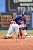 New York Mets shortstop Ruben Tejada (11) tags out Bryce Harper (34) sliding into second during a spring training game against the Washington Nationals on March 27, 2014 at Tradition Field in St. Lucie, Florida.  Washington defeated New York 4-0.  (Mike Janes/Four Seam Images)