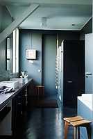 The bathroom is spacious enough for a concrete surface 5metres long with more than enough room for two large wash basins