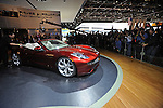 A man cleans the luxury electric Fisker Karma S before its unveiling at the Detroit Auto Show in Detroit, Michigan on January 12, 2009.