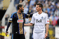 Gabriel Gomez (6) of the Philadelphia Union talks with Sebastien Le Toux (7) of the Vancouver Whitecaps during a stoppage in play. The Philadelphia Union and the Vancouver Whitecaps played to a 0-0 tie during a Major League Soccer (MLS) match at PPL Park in Chester, PA, on March 31, 2012.