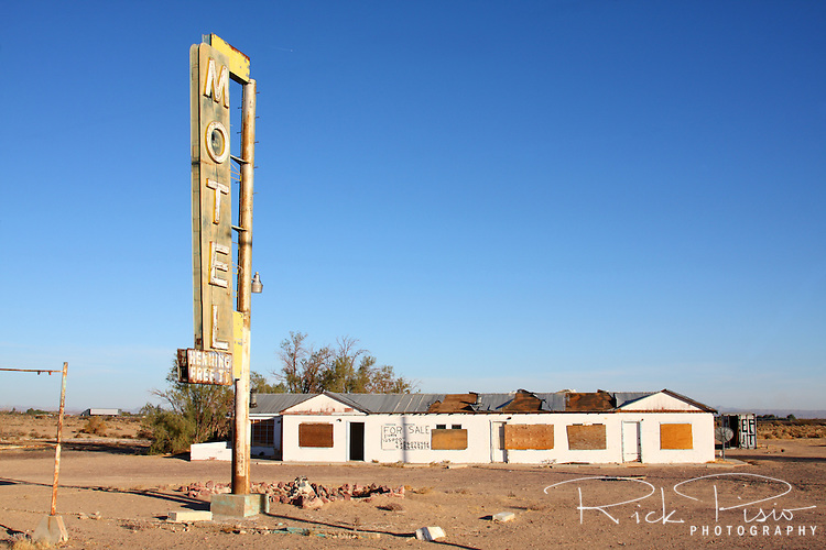Abandoned motel and neon sign along Route 66 in Newberry Springs, California. Prior to the construction of Interstate 40 Route 66 was the primary road through the Mojave Desert.