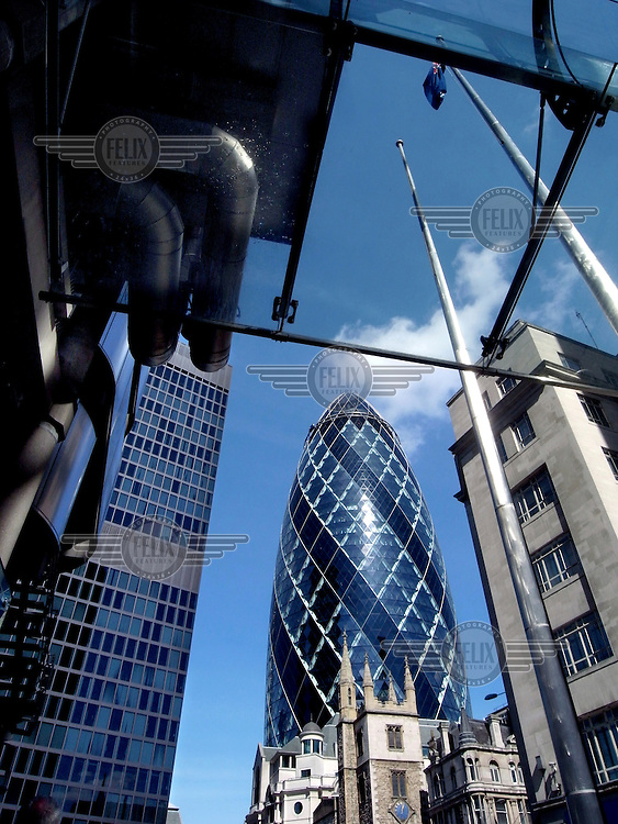 The Swiss Rae Tower (the Gherkin) seen from beneath the Lloyd's building in the City of London.