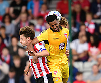 Morecambe's Vadaine Oliver vies for possession with Lincoln City's Alex Woodyard, left, and Lincoln City's Sean Raggett<br /> <br /> Photographer Chris Vaughan/CameraSport<br /> <br /> The EFL Sky Bet League Two - Lincoln City v Morecambe - Saturday August 12th 2017 - Sincil Bank - Lincoln<br /> <br /> World Copyright &copy; 2017 CameraSport. All rights reserved. 43 Linden Ave. Countesthorpe. Leicester. England. LE8 5PG - Tel: +44 (0) 116 277 4147 - admin@camerasport.com - www.camerasport.com