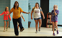 NWA Democrat-Gazette/ANDY SHUPE<br /> Instructor Jules Taylor works Tuesday, March 21, 2017, with actors Viola Kelley, (from left) 10; Violet Newberry, 10; Kayla Henderson, 12; and Ayla Fortin, 11; during the Broadway Bound Theater camp at Arts Live Theater in Fayetteville. The spring break camp will culminate with a performance at the end of the week.