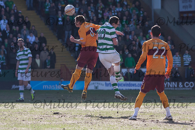 Steve Jennings wins the aerial duel with Anthony Stokes