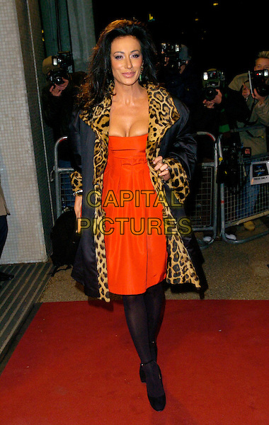 "NANCY DELL'OLIO.Arrivals - ""An Audience With Lionel Richie"" TV recording, ITV Television Centre, Aouth Bank, London, England, December 9th 2006..full length red dress leopard print coat black tights.CAP/CAN.©Can Nguyen/Capital Pictures"