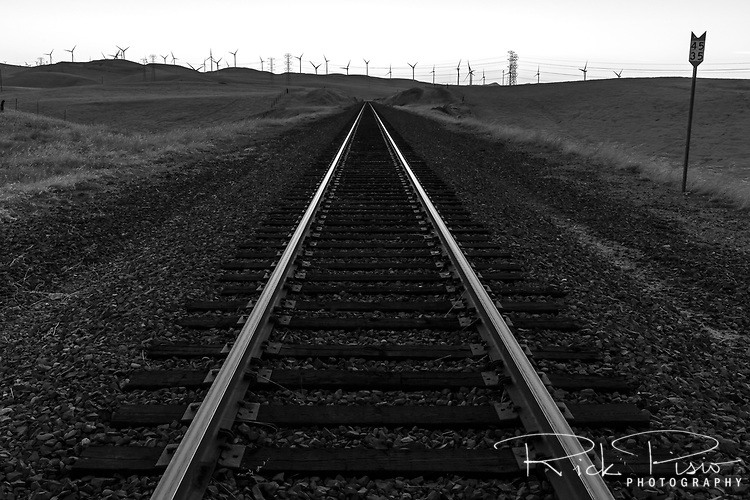 Union Pacific rails head west into the Altamont Pass at dusk west of Tracy, California