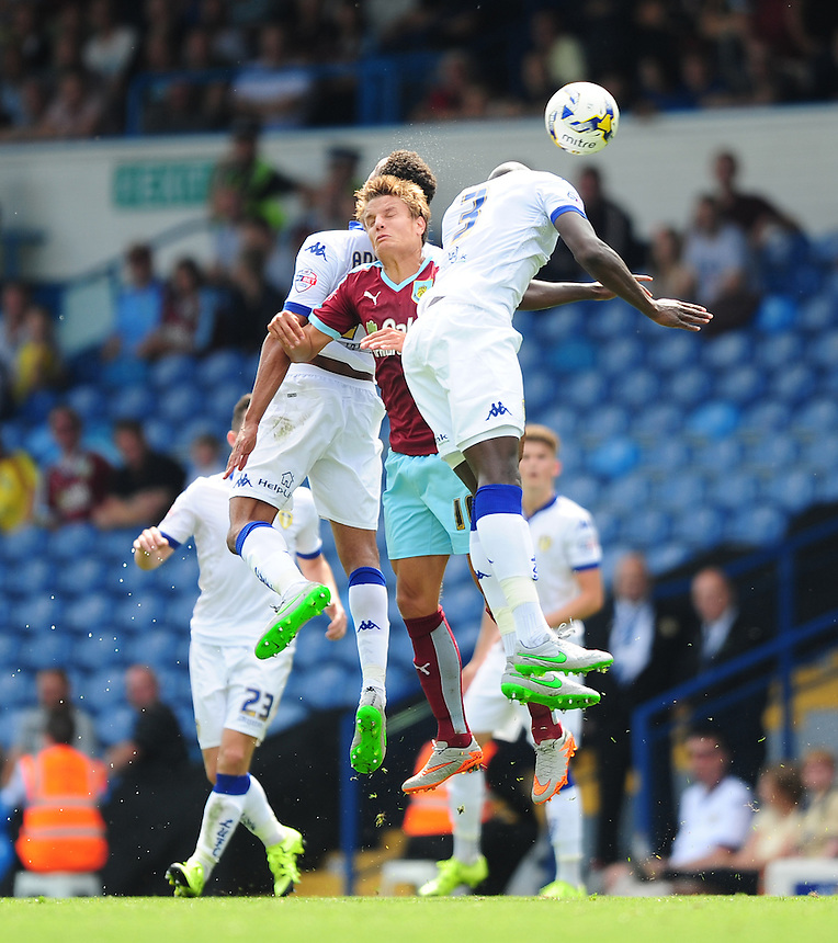 Burnley's Jelle Vossen vies for possession with Leeds United's Tom Adeyemi, left, and Leeds United's Souleymane Bamba<br /> <br /> Photographer Chris Vaughan/CameraSport<br /> <br /> Football - The Football League Sky Bet Championship - Leeds United  v Burnley - Saturday 8th August 2015 - Elland Road - Beeston - Leeds<br /> <br /> &copy; CameraSport - 43 Linden Ave. Countesthorpe. Leicester. England. LE8 5PG - Tel: +44 (0) 116 277 4147 - admin@camerasport.com - www.camerasport.com