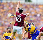 Joseph Cooney of Galway in action against Peter Duggan of Clare during their All-Ireland semi-final replay at Semple Stadium,Thurles. Photograph by John Kelly.