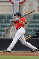 Left fielder Carl Thomore (13) of the Kannapolis Intimidators bats in a game against the Charleston RiverDogs on Saturday, June 28, 2014, at CMC-Northeast Stadium in Kannapolis, North Carolina. Kannapolis won, 4-3. (Tom Priddy/Four Seam Images)