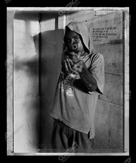 """Eddie,"" Raskols, gangs of Port Moresby, Papua New Guinea, January 2004"