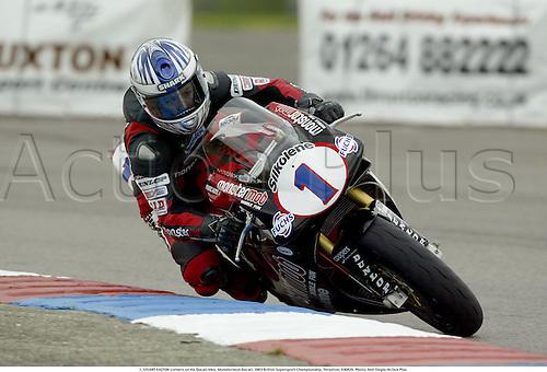 1. STUART EASTON corners on his Ducati bike, Monstermob Ducati, 2003 British Supersport Championship, Thruxton, 030420. Photo: Neil Tingle/Action Plus...motor motorsport motorsports bike bikes superbikes.cornering