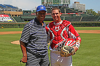 """Catcher Tomas Nido #16 with Hall of Fame Cubs legend Ernie Banks, aka """"Mr. Cub"""" after catching the ceremonial first pitch before the Under Armour All-American Game at Wrigley Field on August 13, 2011 in Chicago, Illinois.  (Mike Janes/Four Seam Images)"""