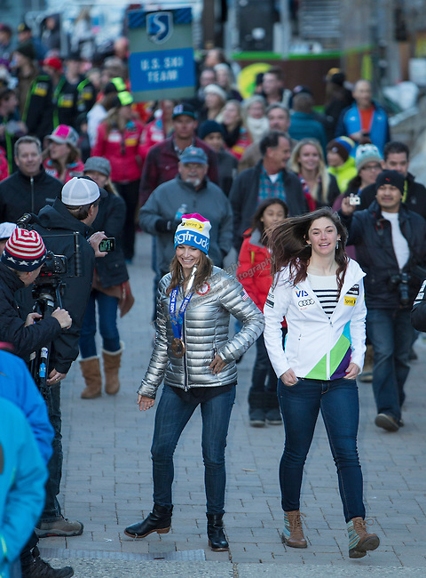 Julia Mancuso, left, walks in a parade during the Olympic Homecoming Celebration at Squaw Valley on Friday night, March 21, 2014.
