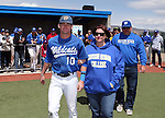 Western Nevada College's Alex Fife escorts his family onto the field for Sophomore Day festivities at John L. Harvey field, on Sunday, April 27, 2014, in Carson City, Nev.<br /> Photo by Cathleen Allison/Nevada Photo Source