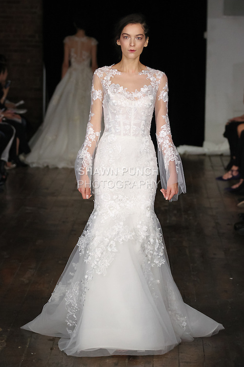 """Model walks runway in a """"Fate"""" bridal gown from the Alyne by Rita Vinieris Fall 2017 collection on October 7th, 2016 during New York Bridal Fashion Week."""