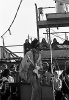 Jimi Hendrix performing his legendary 2 hour performance at Woodstock Music &amp; Arts Festival held on Sam Yasgur's alfalfa field in Sullivan County in Bethal, New York on August 18, 1969. Hendrix insisted he close the festival and was scheduled to appear at midnight but due to delays did not take the stage until 9 a.m. Monday morning. Most of the crowd had left for home by then and had dwindled from a whopping 500,000 to measly 80,000. <br /> ** HIGHER RATES APPLY ** CALL TO NEGOTIATE RATE ** NEVER BEFORE PUBLISHED PHOTOS **<br /> &copy; Peter Tarnoff / MediaPunch