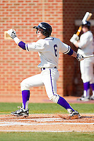 Devin Bujnovsky #6 of the High Point Panthers follows through on his swing against the Dayton Flyers at Willard Stadium on February 26, 2012 in High Point, North Carolina.    (Brian Westerholt / Four Seam Images)