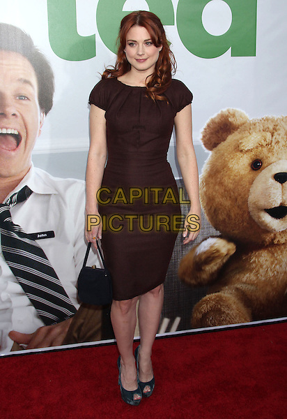 Alexandra Breckenridge.The L.A. Premiere of 'Ted' held at The Grauman's Chinese Theatre in Hollywood, California, USA..June 21st, 2012.full length dress  black handbag purse bag brown.CAP/ADM/RE.©Russ Elliot/AdMedia/Capital Pictures.