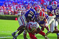 Brandon Bennett (33), Anthone Lott (9), Michael Gilmore (35), Dexter Daniels (48), University of Florida Gators defeat the University of South Carolina Gamecocks 48-17 at Ben Hill Griffin Stadium, Florida Field, Gainseville, Florida, November 12, 1994 . (Photo by Brian Cleary/www.bcpix.com)