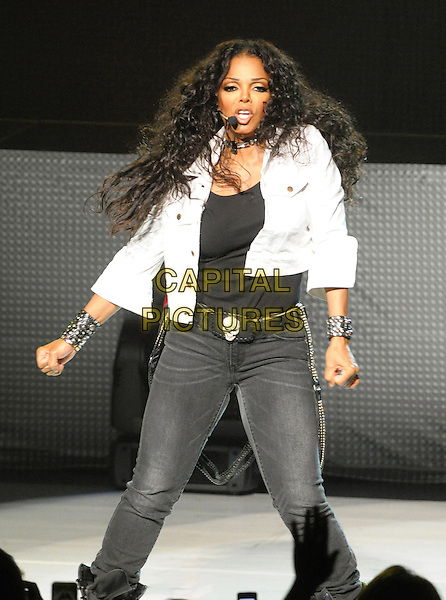 "Janet Jackson.Janet Jackson performs during her ""Number Ones: Up Close and Personal"" World Tour, Hamilton, Ontario, Canada, .3rd August 2011..half 3/4  length jeans dancing concert gig live on stage white shirt jacket singing  skull belt black grey gray .CAP/ADM/BPC.©Brent Perniac/AdMedia/Capital Pictures."