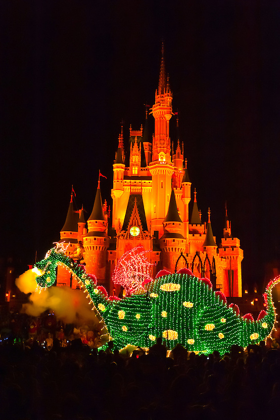 Pete's Dragon (and Elliott), Disney's Electrical Parade (with Cinderella Castle in back), Magic Kingdom, Walt Disney World, Orlando, Florida USA