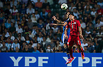 (L) Leonel Vangioni of Argentina competes for the ball with (R) Chi Ho Lee of Hong Kong during the HKFA Centennial Celebration Match between Hong Kong vs Argentina at the Hong Kong Stadium on 14th October 2014 in Hong Kong, China. Photo by Aitor Alcalde / Power Sport Images